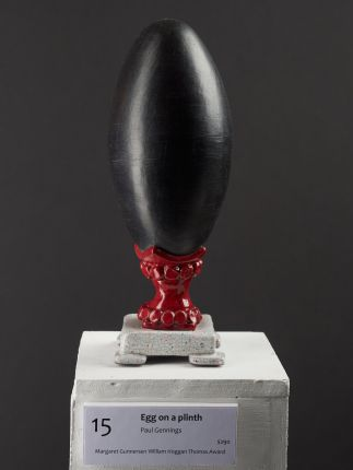 Egg on a plinth