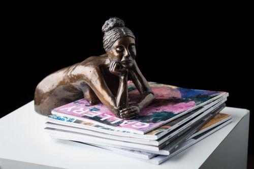 Girl On Books sculpture by Eva Ermer